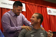 Yadier Molina greets retired pitcher Chris Carpenter on the first day of the 2014 Cardinals Winter Warm-Up.