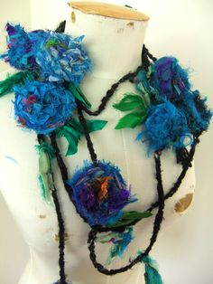 Romantic blue flowers necklace handmade by plumfish. Her work always reminds me of Monet's floating flowers.