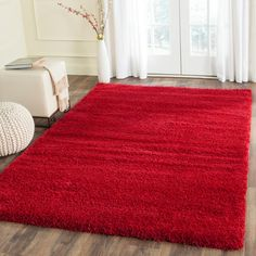 Add fashionable European style to your home or office with this radiant ivory shag rug from Safavieh's Milan Shag Collection. A treat for the senses, incredibly rich texture and soft yarns make this rug a perfect option for adding warming texture and Red Shag Rug, Red Living Room Decor, Bedroom Decor, Silver Bedroom, Carpet Trends, Cheap Carpet Runners, Red Rooms, Diy Carpet, Carpet Styles