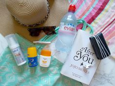 poolside beachside vacation hoilday essentials hat book sunglasses sun lotion spf ladival nivea roll on eucerin book water ipod beach bag towel