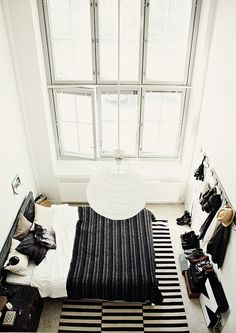 love the idea of wall coat racks in the master bedroom - would help get everything off the floor!