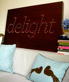 Spell it out...Feeling ambitious? This DIY twinkly typographic art is worth the effort. Print out a stencil and lay over top of the wood panel, then drill holes to spell out the word and insert the bulbs accordingly.