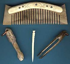 personal grooming aids: comb, tweezers, tooth pick and ear spoon.