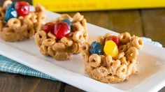 Add some fun to your Easter table with peanut butter-Cheerios™ cereal nests that hold your favorite candy eggs.