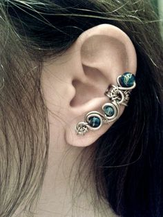 Ear Cuff inspired by SciFi and Tech. The curling style of this cuff creates a colorful and bright look depending on the color of the beads. The blue