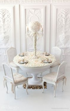A plush bed of white rose petals is the ultimate in intimate luxury tabletop decor as seen on this beautiful setting for four. Floral and de...