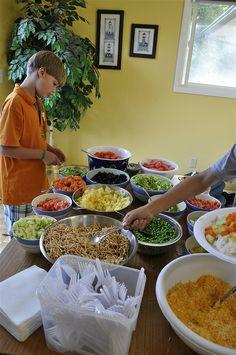 Hawaiian Haystacks, Cafe Rio, etc... Using food themes to feed the masses.