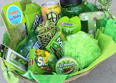 color themed gift basket: water bottle, peace tea, loofa, picture frame, life savers, fruit gum, skittles, mike and ikes, ice breakers, juicy drop, Christmas ornaments, clay mask, nail polish