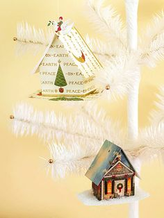 Home for the Holidays     Refashion holiday cards into charming tree decorations. Cut side, roof, and base shapes from Christmas cards. Cut, fold, and use crafts glue to secure the seams and pieces. Embellish the houses with additional motifs from the cards, or add a bit of snowy shimmer by coating the bases or rooftops with crafts glue and a dusting of glitter