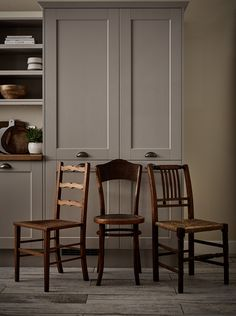 Mix and match reclaimed chairs in similar tones to complete the Shaker look. Fairford Cashmere Kitchen from The Shaker Collection by Howdens Joinery. Kitchen Doors, Kitchen Chairs, Kitchen Furniture, Kitchen Interior, Kitchen Design, Primitive Furniture, Pantry Doors, Dining Chairs, Howdens Kitchens