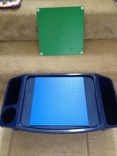 Kids tray and Lego base plates. Add velcro and voila! Cheap & easy Lego table they can carry everywhere!