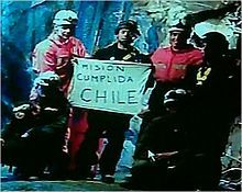 "Slightly grainy color video capture image of the six rescuers displaying the famous ""Mision Cumplida Chile"" sign deep within San José Mine near Copiapo, Chile. - 2010"