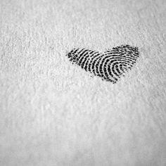 Thumbprint heart tattoo