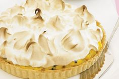 This classic meringue tart is given a tropical twist with the addition of passionfruit, pineapple and coconut cream.