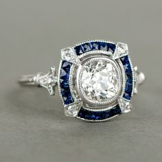 Not the best cut, but a classic beauty...Antique Cushion Cut Diamond and Sapphire Halo Platinum