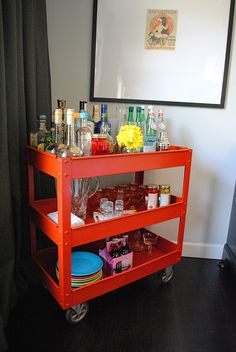 DIY Bar Cart...no wheels, but love the industrial look with a pop of color. Great mix of casual and contemporary