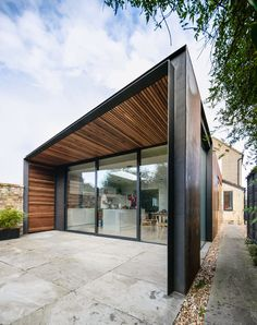 Architect Henry Goss has completed a rusted steel and timber-clad extension to a house near Cambridge, England, two years after Dezeen published the hyper-realistic renderings that changed his life House Cladding, Timber Cladding, Facade House, Residential Architecture, Architecture Design, Steel House, Minimalist Home Decor, House Extensions, Prefab Homes