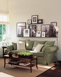leaning pictures on long shelf @ Home Improvement Ideas