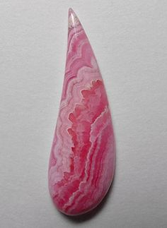 Rhodochrosite- representing selfless love and compassion. Heals sexual abuse. Lifts a depressed mood while encouraging a positive attitude.