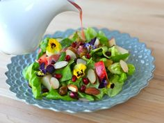 Tu B'Shevat Salad with Pomegranate Dressing. Traditionally, a bounty of fruits and vegetables grace the Tu B'Shevat table.