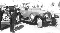 The photograph shows the Rolls-Royce Silver Ghost 1921 carrying Governor of Bombay Sir Frederick Sykes (right rear seat) and Maharaja Sir Vijaysinhji (left rear seat) at Rajpipla in 1929, followed by the Rolls-Royce 20 h.p. 1922, and the Rolls-Royce Silver Ghost 1913.