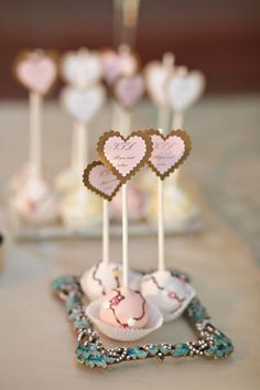 What a pretty idea ~ to showcase your cake pops in gorgeous little frames! Photography by table4weddings.com