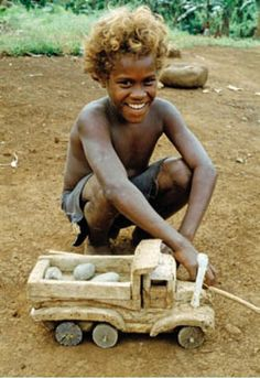 International Week of Solidarity with the Peoples  of Non-Self-Governing Territories   May 25-31: Image is of a young boy in Malaita, Solomon Islands, playing with his homemade wooden truck, 1987. UN Photo/W Stone.