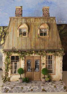 My french style mansard roof dollhouse is done.  It's called La Maison de Campagne.    All the chandeliers, porch light and fireplace are ru...