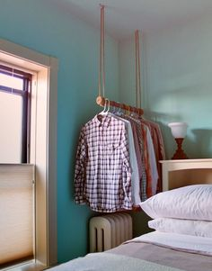 DIY Hanging Garment Rack - perfect for small spaces, plus saves floor space.