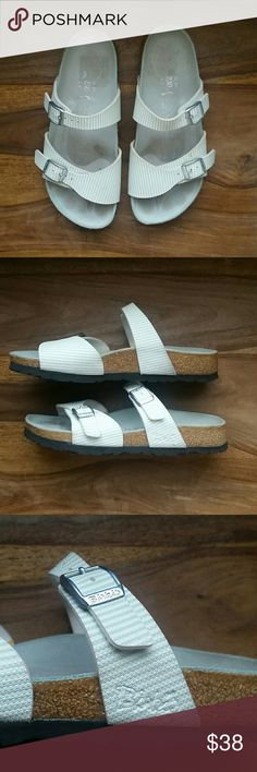 Birki's Sandals Birki's by Birkenstock double strap sandals. Silver buckle accent. Mint/sea foam green and white pin stripped pattern. Suede covered cork. Besides the toe prints, minimal signs of wear. Birkenstock Shoes Sandals