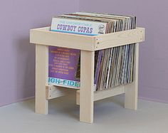 Solid douglas fir LP record stand. Displays 35 records and optimizes browsing. Sides and base slot together and ships flat. The wood is sanded with all machine marks removed but left unfinished. Great care is taken to keep all parts of item from same board. Enjoy the wood in its natural state or stain to your preference.  Beautiful display for your choice records. Suitable for table top/ or stereo cabinet placement. Ready to ship same day or next.  Dimensions with records: 12w x 12d x 15...