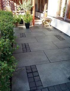 Graphite gray granite tiles m², surrounded by black paving stones in basalt. – Marin van der Meer - All About Concrete Patios, Brick Patios, Garden Floor, Garden Paving, Garden Planter Boxes, Wall Planters, Granite Tile, Gray Granite, House Extension Design