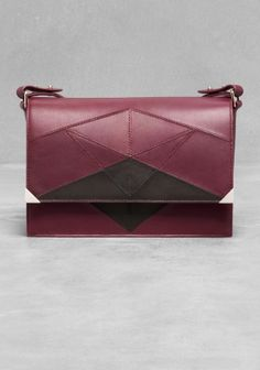 A chic leather shoulder bag crafted from smooth leather, featuring a graphic pattern comprised of seams. £95