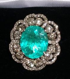 14k Gold 7 11 Ct Certified GIA Paraiba Tourmaline Diamond Flower Ring. ||  ♡ I WOULD LOVE TO BE ABLE TO JUST SEE THIS, ESPECIALLY BECAUSE IT'S FROM THE ORIGINAL FIND, NOT THE NEWER ONES FROM MADAGASCAR!   LOOK AT THAT COLOR! NOTHING CAN COMPARE.....GORGEOUS!!  ♥A