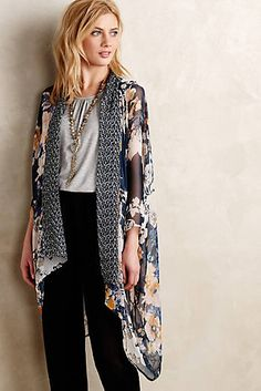 A flowy kimono over tailored dark bottoms is a great look for a casual day at the office.  Bonus, this look transitions perfectly into the evening!