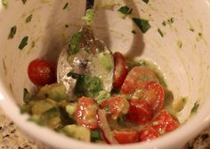 Tomato-Avocado Toss  1/3 cup chopped fresh cilantro  1/4 cup olive oil  2 Tbsp red wine vinegar  2 Tbsp fresh lime juice  1/2 tsp sea salt  1 pint cherry or grape tomatoes  one half of a red onion  2 ripe avocados  salad greens of your choice    Cut tomatoes in half. Thinly slice onion. Peel and cut avocado into small chunks. (If you've never done it before, you might be wondering how to cut an avocado. Clickherefor tutorial). Whisk together first 5 ingredients in a large bowl. Add…