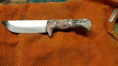 Handmade knife in carbon steel with pink camo handle.