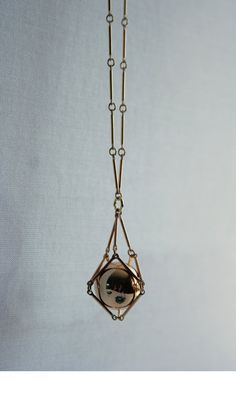 Gold geometric necklace with caged ball skinny by LANGUAGEjewelry, $59.00