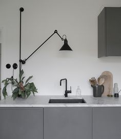 Minna Jones' dark gray kitchen