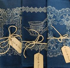 Lovely indigo dyed linen napkins; would go well with a burlap table runner and white tablecloths.