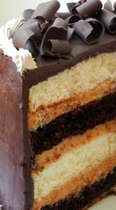 Heaven and Hell Cake ~ It is made with Devils food cake, and Angel Food cake…hence the name! There is a thick filling of peanut butter filling, and it is topped with thick chocolate ganache!
