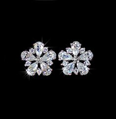 $14 White gold plated top quality Cubic Zicronia flower stud earrings, AE0028 by AmodeJewelry on Etsy https://www.etsy.com/listing/194510119/white-gold-plated-top-quality-cubic