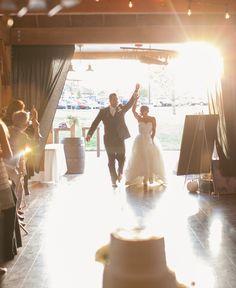 Bride and groom entrance at barn wedding reception