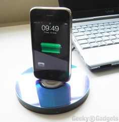 Old CDs that are really scratched up? Or just plain terrible music? Make a little dock for your phone!