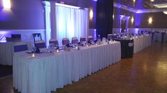 A Wedding Ceremony using 1/3rd of our Grand Ballroom, with the Cocktail Hour in the Commodore Room during which the Grand Ballroom was turned into a full room Reception for around 120 guests! Accents of ivory, purple & silver cover this wedding!