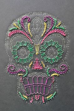 I have to do this on a large piece of wood as a collaborative piece. Love it!! Wood, nails, yarn....can't wait!!