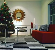 [New] The 10 All-Time Best Home Decor (Right Now) - Apartment by Jennie Cross - Our red sectional sofa on loan for a holiday photo shoot! Red Sectional Sofa, Modern Furniture, Furniture Design, Christmas Decorations, Holiday Decor, Holiday Photos, Midcentury Modern, Photo Shoot, Home Decor