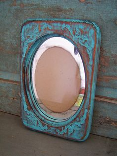 This is a wooden frame hand painted in turquoise blue, hand distressed and hand waxed. Glass and backing is included. Painted Frames, Wooden Frames, Hand Painted, Distressed Picture Frames, Hand Wax, Chalk Paint, Mirrors, Carving, Turquoise