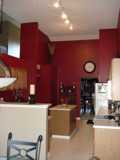 red kitchen walls with medium brown cabinets | ??, 16ft vaulted ceilingsnatural wood cabinets and scarlet red walls ...