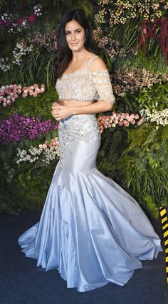 Katrina Kaif in a cold-shoulder blue mermaid style outfit at Reception. Indian Wedding Gowns, Party Wear Indian Dresses, Designer Party Wear Dresses, Indian Gowns Dresses, Indian Bridal Outfits, Dress Indian Style, Indian Fashion Dresses, Indian Designer Outfits, Indian Reception Outfit